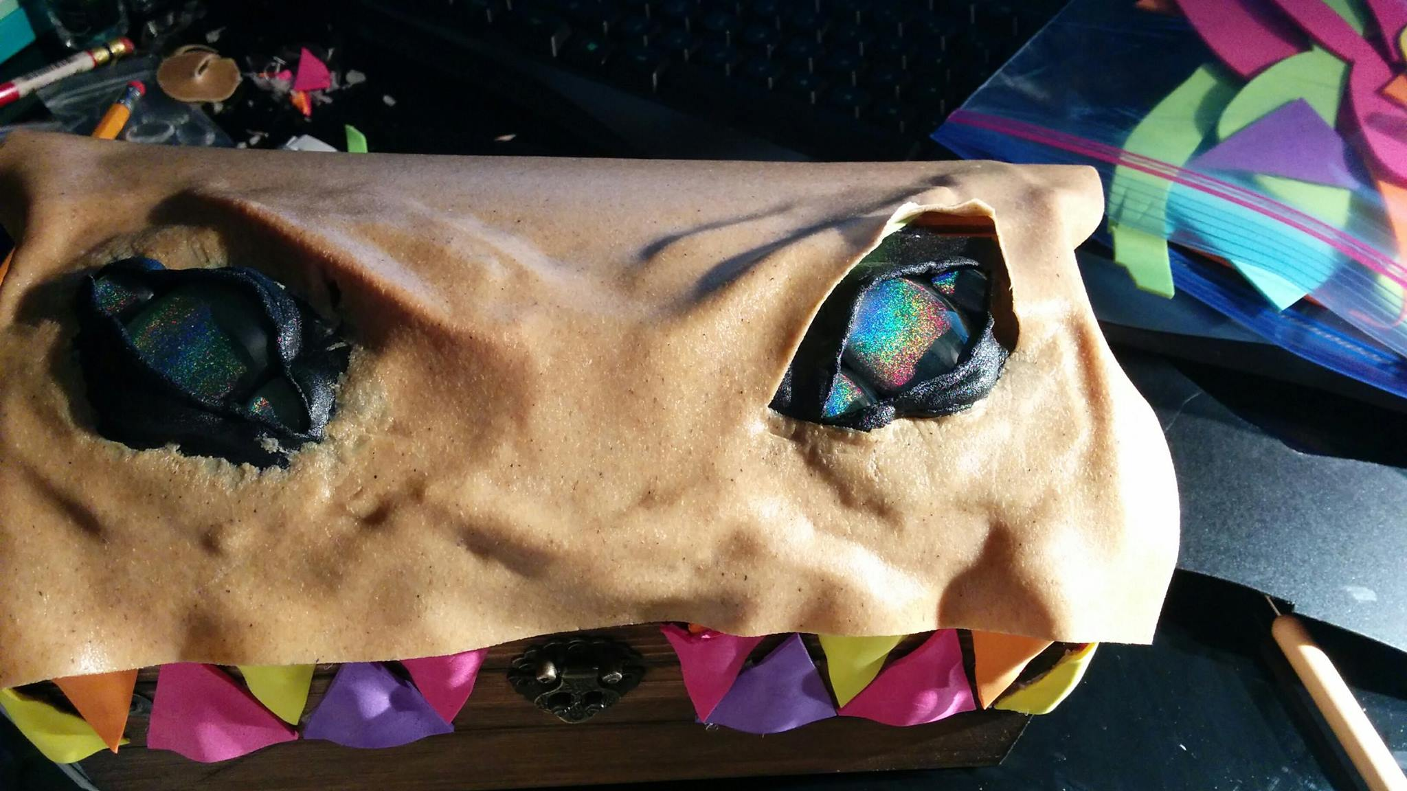 I placed some more foam on the box where I wanted features to pop out, and then covered in another sheet of worbla, leaving holes for the eyes to come through.  Instead of worbla, this could also work with clay or even paper mache!