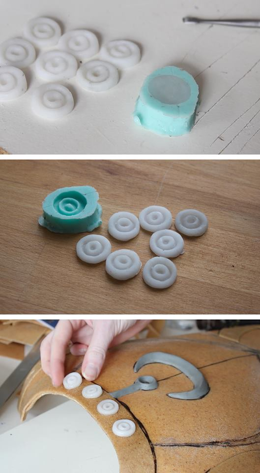 A mold used to make many quick copies of a  button shape by Lightning Cosplay. This would take much longer with resin, so Deco Art allows smooth casting without worrying about fumes or time.