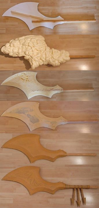 expanding foam carved into shape and then covered in Worbla for a lightweight prop. By Kamui.